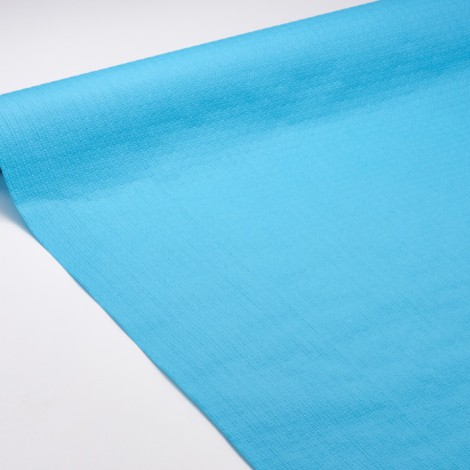 Nappe en papier turquoise gaufrée pour des dîners colorés.