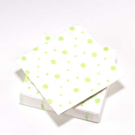 Serviettes blanches à pois vert